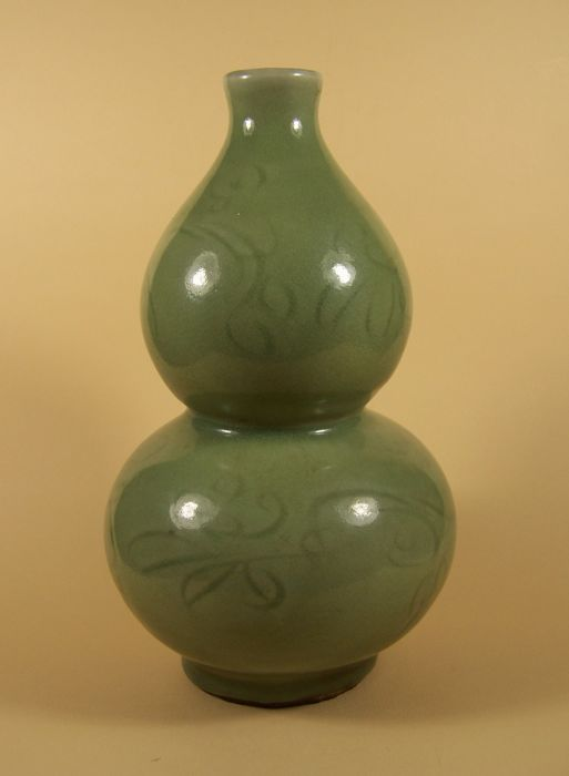 A celadon ('longquan') double gourd-shaped vase - China (Zhejiang province) - 16th century (Ming dynasty)