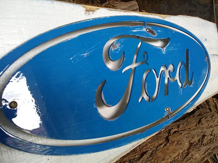 Large sized wooden panel with FORD metal logo