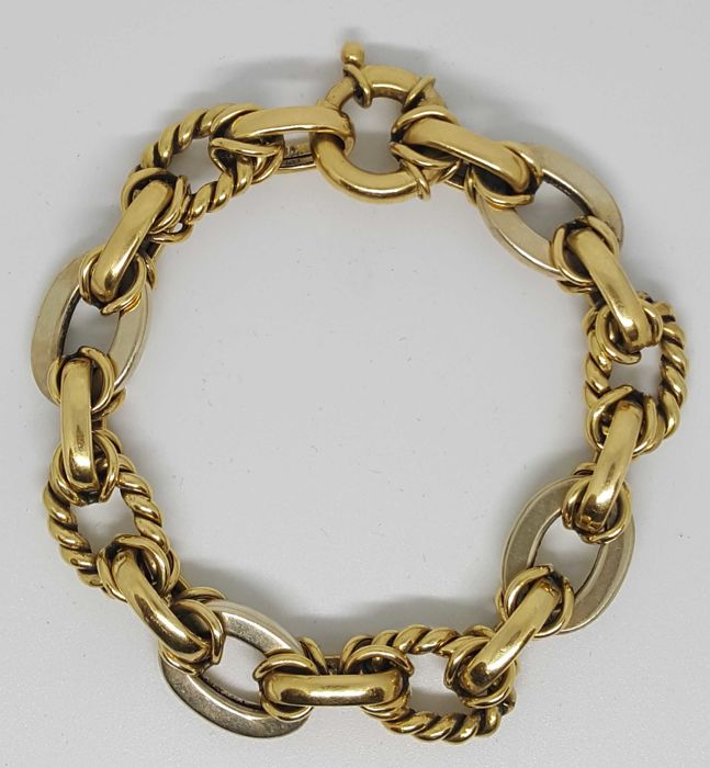 Two-tone 18 kt gold bracelet 31.8 g and 21 cm in length