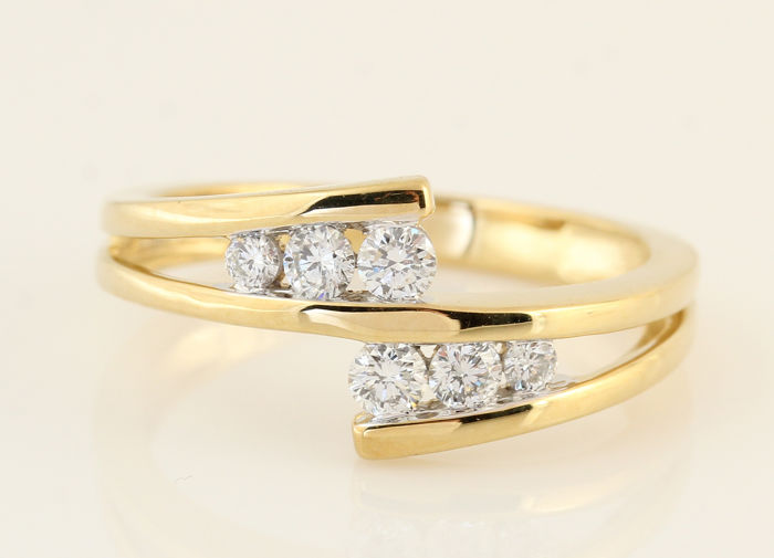 18 kt yellow gold diamond ring of 0.28 ct in total / weight: 3.3 g / G-H VS1-SI1 / ring size: 50 /