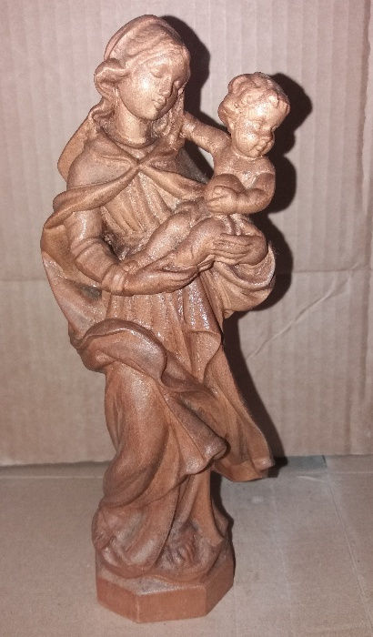 An antique oak wood carving of Mary with the Child on her lap. Early 20th Century.