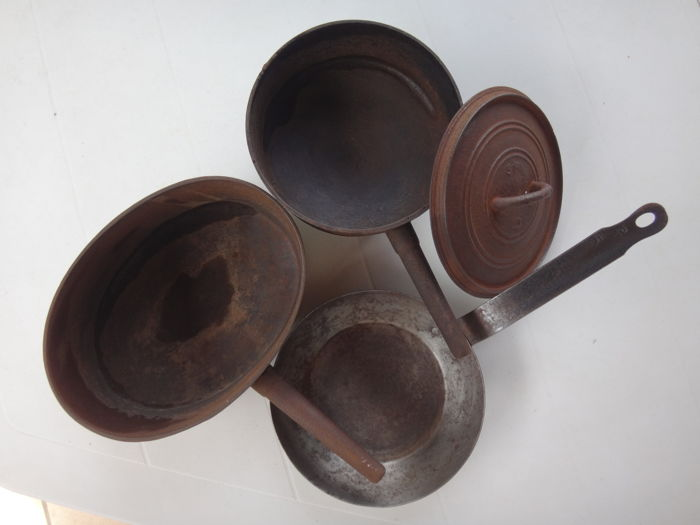 2 Old cast-iron cooking dishes and a metal frying pan