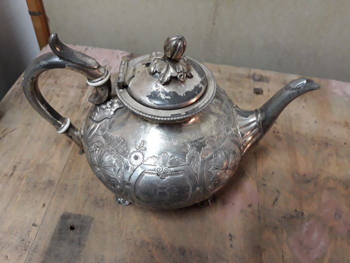 Antique teapot not silver - numbered on the bottom - hand rolled