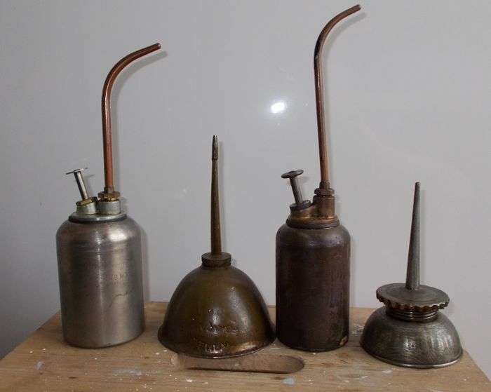 Four vintage French oil cans with spout