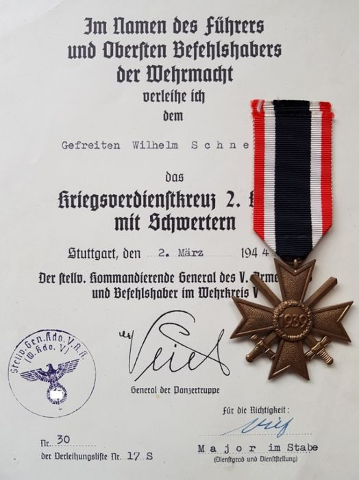 Third Reich medal including documents.