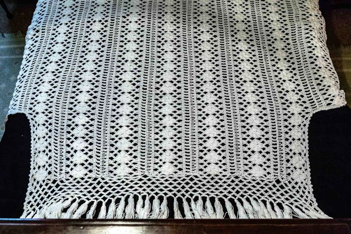 white cotton crocheted quilt