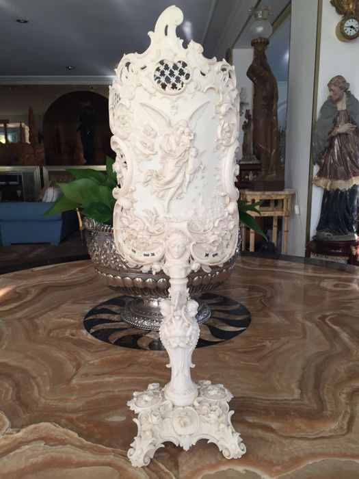 Ivory candle screen richly carved in Rococo style with an angel in flight, floral motives and scrolls, South Germany, circa 1860-1880