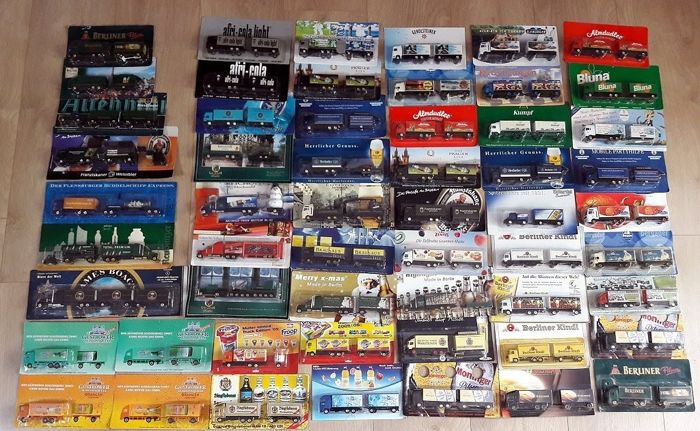 Collection with 56 model trucks, beer advertising, etc, truck with trailer, mint condition in original packaging
