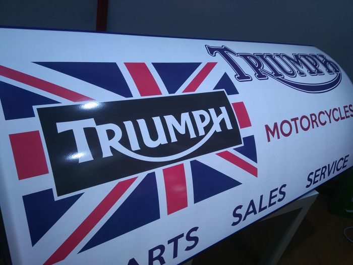 Large sign of TIUMPH MOTORCYCLES