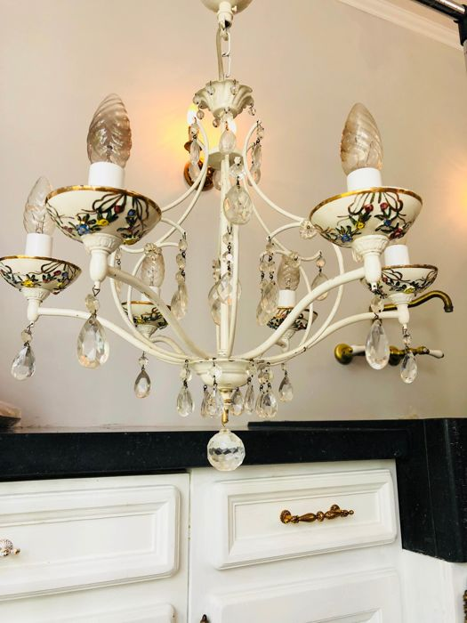 A beautiful brocante Italian chandelier with porcelain bowls and crystal pendants and painted with yellow and blue flowers