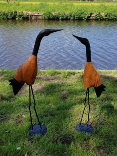 Two large (76 cm and 72 cm) handmade metal birds with wooden body/sculpture