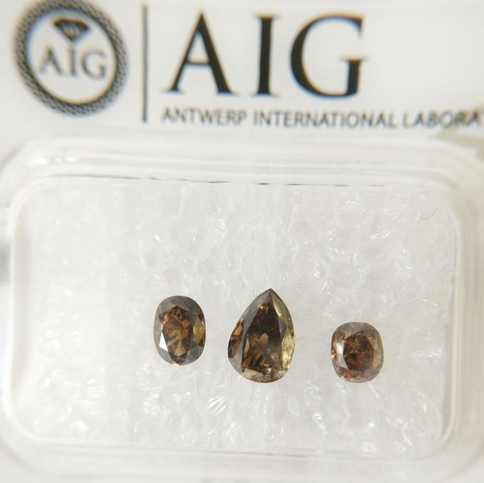 Triple of 3 Pear & Oval cut diamonds total 0.89 ct Fancy Deep Yellowish Brown SI2-I1 *** No Reserve ***
