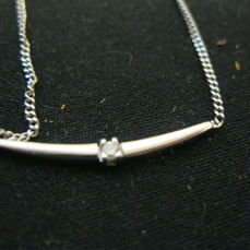 A white gold necklace, 585, with a small brilliant cut diamond