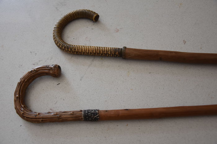 Pair of sticks with resin handles, one bears a silver band with flowers, the other a brass circle - Sicily, Italy - 1930s/40s