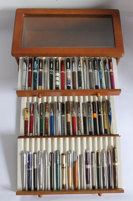 51 collector's fountain pens in gold and silver in their display case