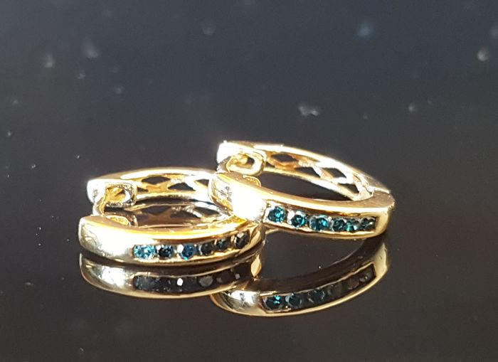 Gold creole earrings with blue Fancy Brilliants