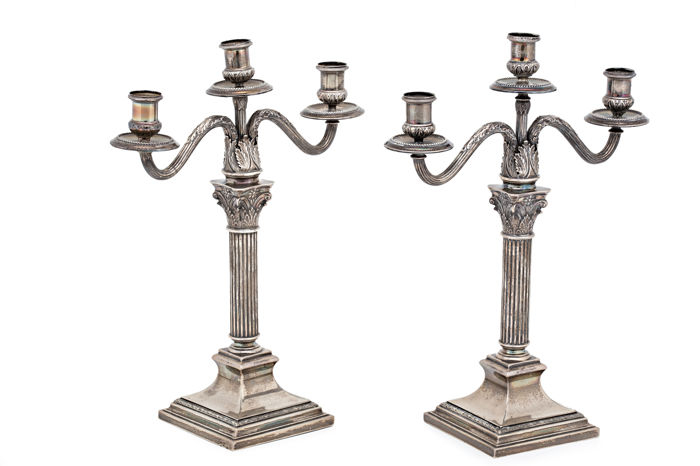 Pair of silver candelabra for three candles. Spain. 20th