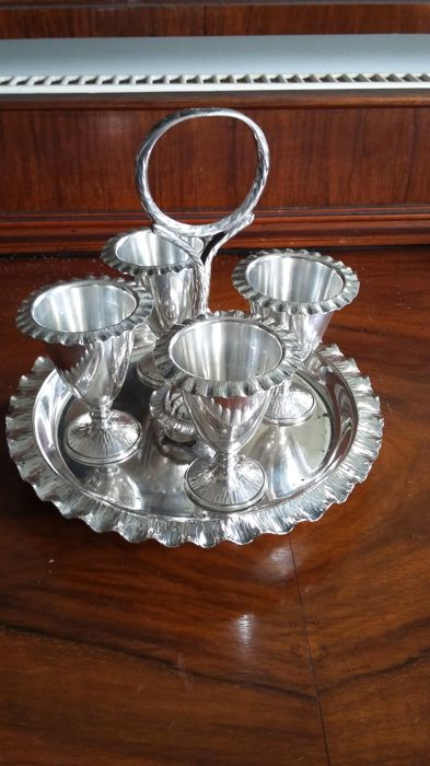 Hukin & Heath,  Birmingham 1875 London mark entered 1879 egg colder set silver plated. made in england.