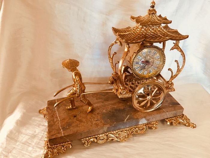 Vintage rickshaw mantel clock in gold plated finishing