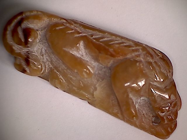A rare chinese nephrite talisman in form a hunting tiger - 54 X 21