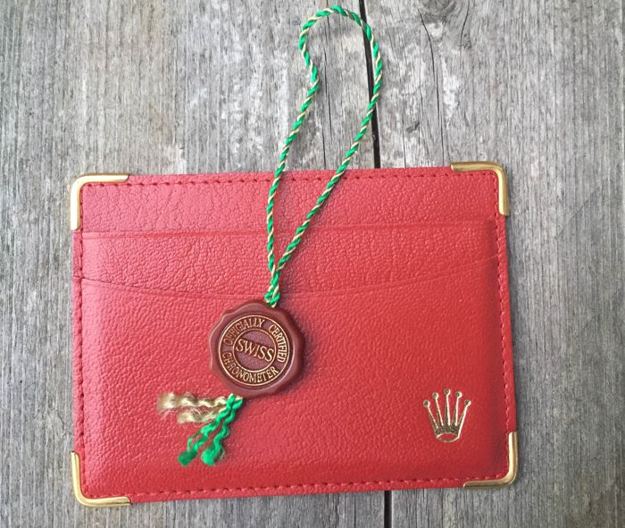 rolex lot of 2 items: red tag and card holder