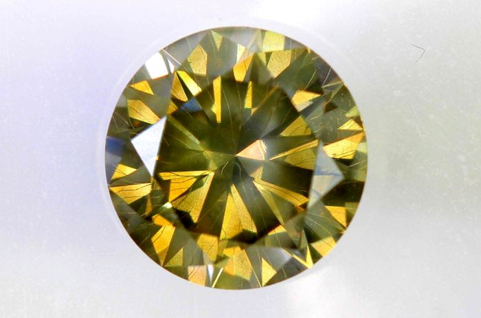 AIG Sealed Diamond - 0.81 ct - Fancy Light Yellowish Brown - SI2