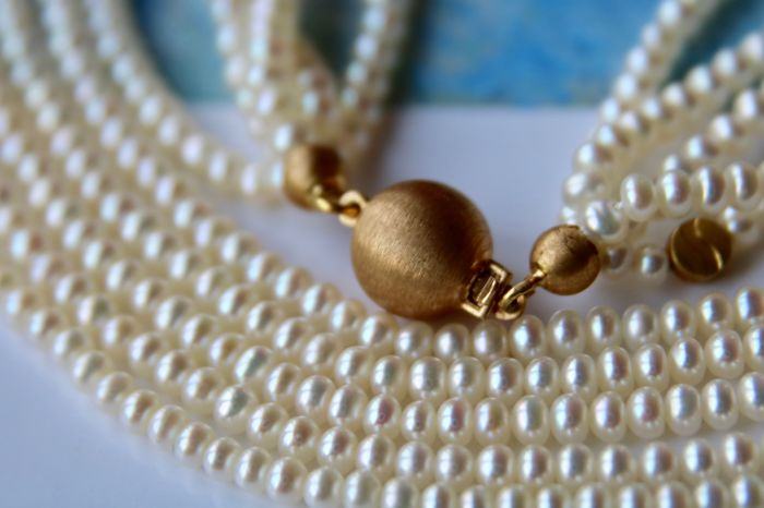 "Five-strand Akoya necklace from ""Schoeffel"" with lustrous sea pearls set with 18Kt. gold clasp in top condition."