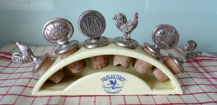 Rarity: REPLAY CAFE advertising set of corks and silver-plated metal stoppers on a porcelain display