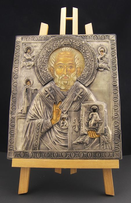 Antique icon from the 18th century, Saint Nicholas, egg tempera on gold background, with precious riza