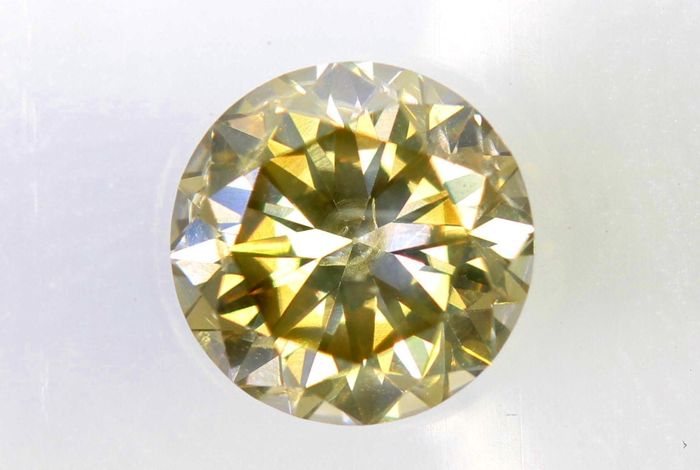AIG Sealed Diamant - 0.72 ct - Fancy Light Yellowish Brown - SI2