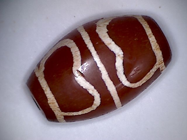 A rare ,beautiful dyed canelian bead with agate inclusions - 24 X 15 mm