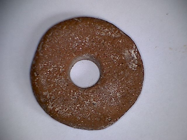 A rare , brownish terracotta bead in form of a Pi disc - 24 mm