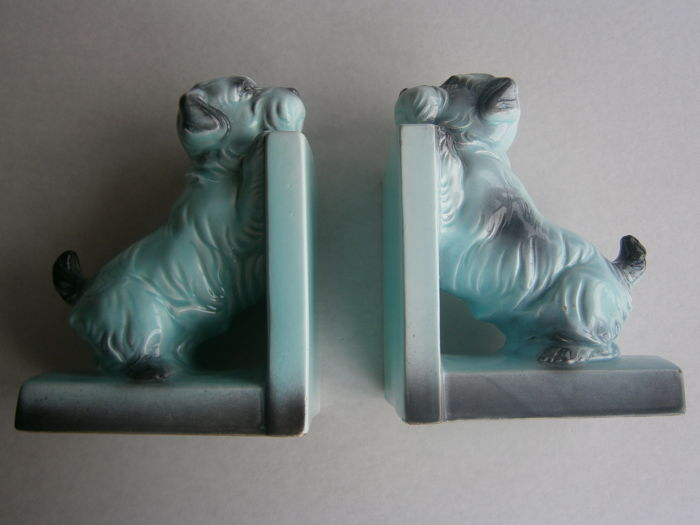 A set of Art Deco pottery bookends in the form of Saint Bernard dogs