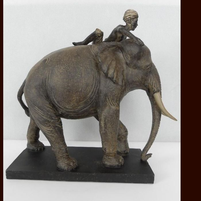 A large, detailed statue of an elephant and a Hindu - 38 cm