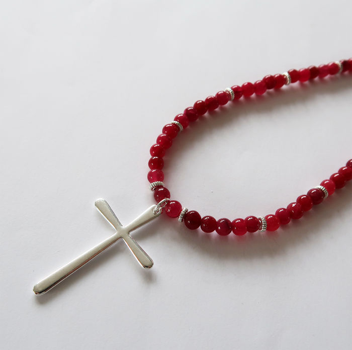 Necklace made of ruby gems, adorned with a silver cross