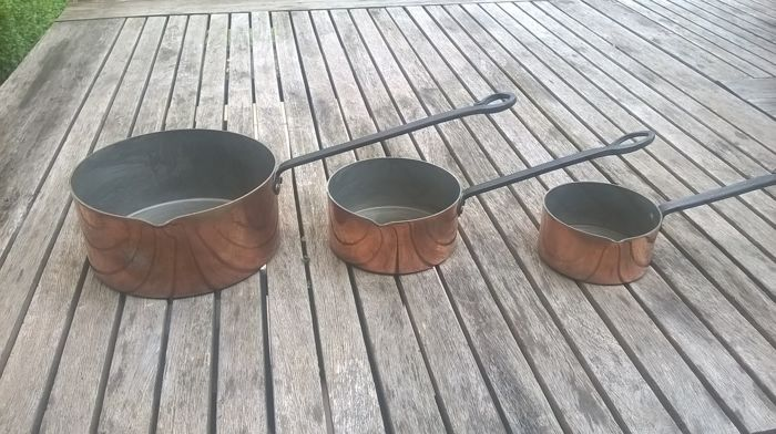 3 copper roasting pans with iron work handles