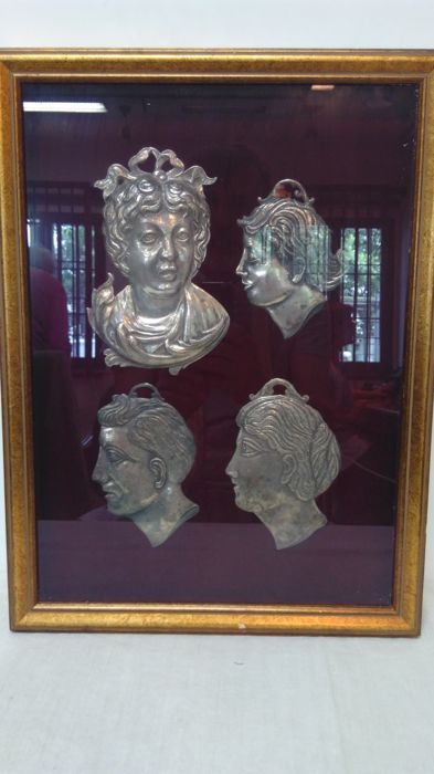 Four silvery metal pieces 'for grace received' early 1900s Italy