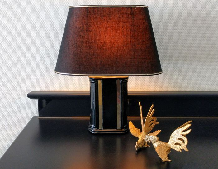 A table lamp - Black ceramic base with gold vertical strips - France, 1980s