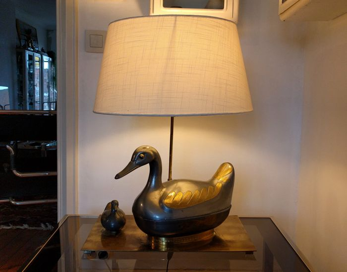 Unknown designer -  Table lamp with sculptured metal duc