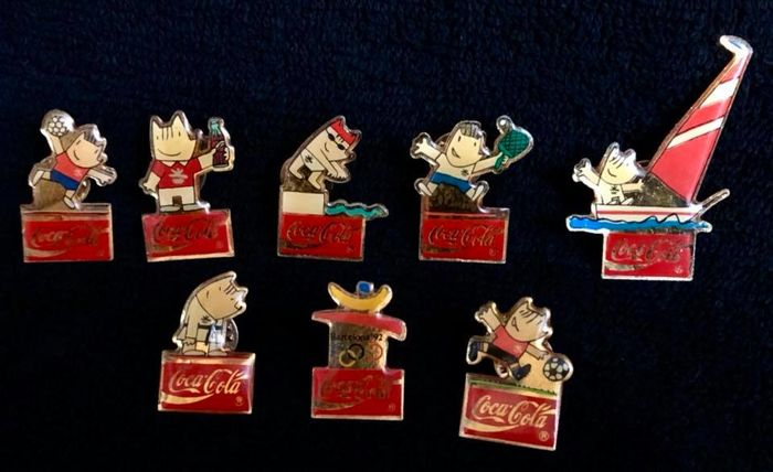 A collection of height  , vintage , Coca Cola , genuine official advertising pins , made in 1980´s for Olympic Games of Barcelona 1992