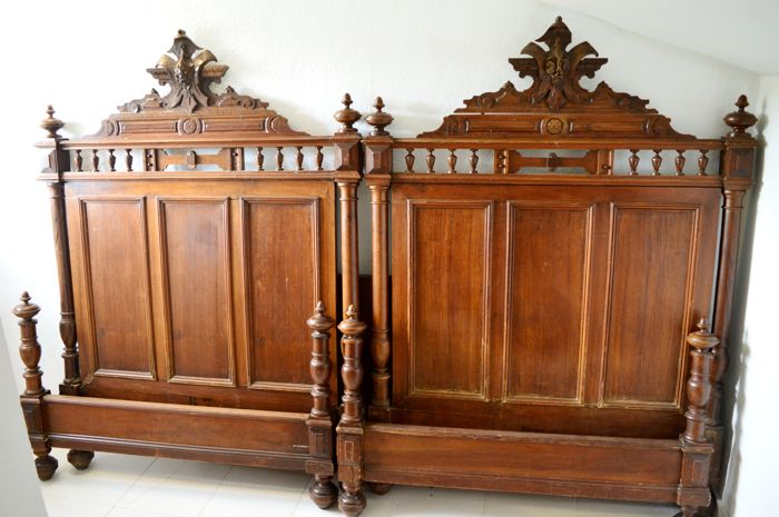Pair of walnut beds, 1890-1920