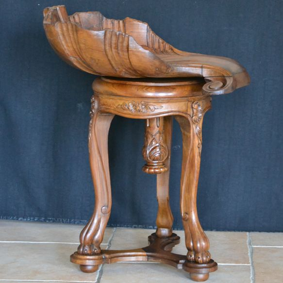 Very old carved stool in the shape of a shell, France, end of 19th century