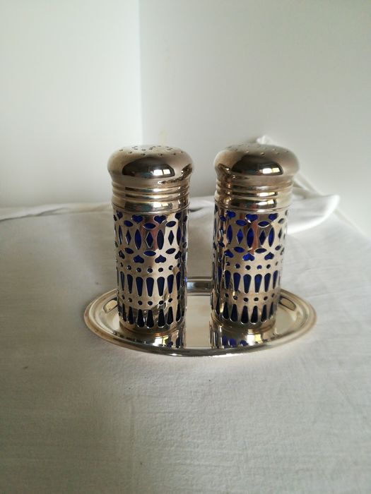 Tray with salt and pepper shakers, silver plated outside, in blue glass inside