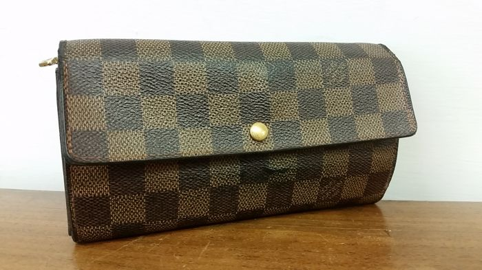 b768841c50177 Louis Vuitton - Sarah long wallet Damier Ebene Wallet - Catawiki