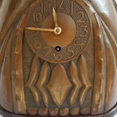 Amsterdam School mantel clock in burnished and hammered copper case