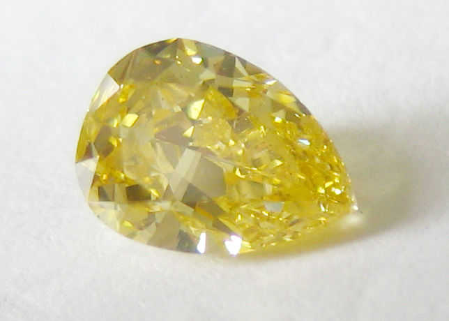 1 pcs Diamond - 1.00 ct - Pear - fancy intens orangy yellow - SI1