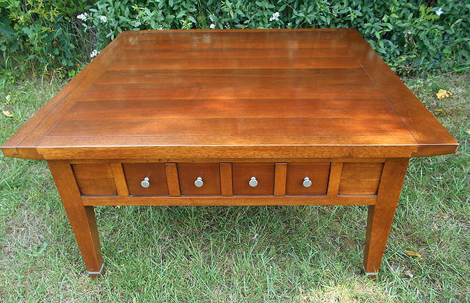 A classic cherry walnut square table with two drawers