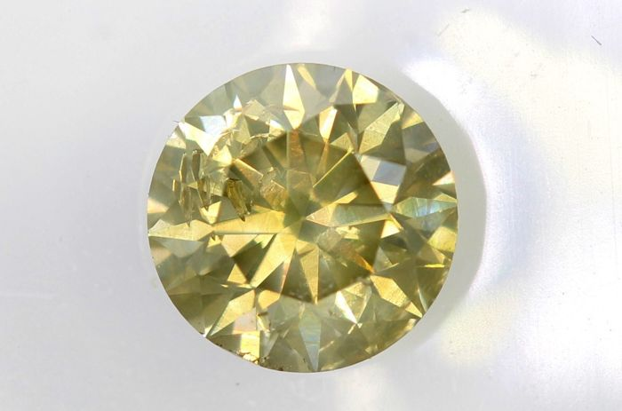 AIG Diamant - 0.70  ct - Fancy Greenish Brownish Yellow