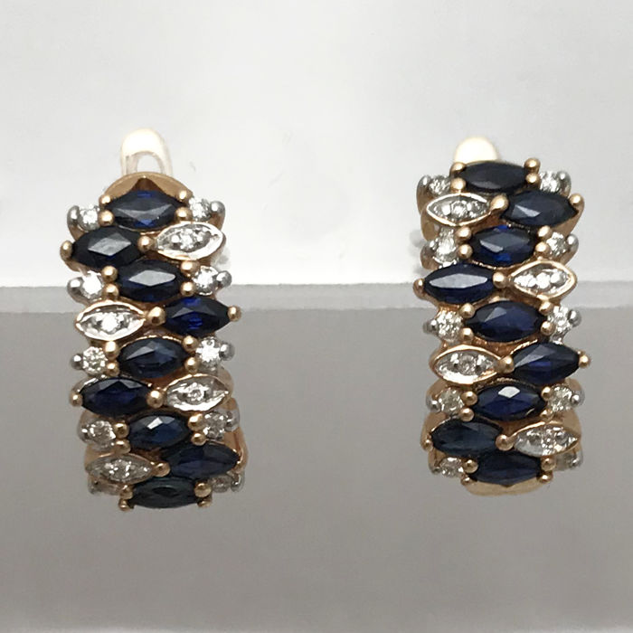 Earrings in 14 kt gold.  Diamond weighing 0.21 ct. Sapphire weighing 2.11 ct. Measurements: 20 x 9 x 15 mm