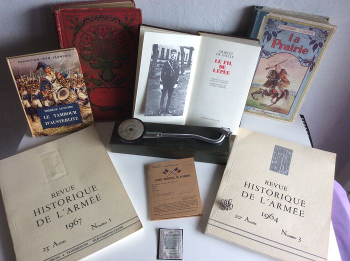 Lot books, a manometer, a pin in silver